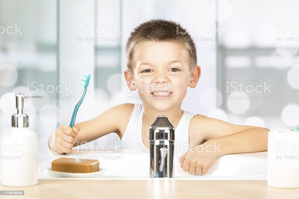 child in bathroom getting ready for school royalty-free stock photo
