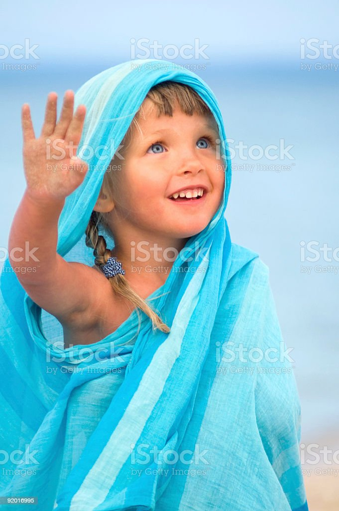 Child in blue pareo royalty-free stock photo