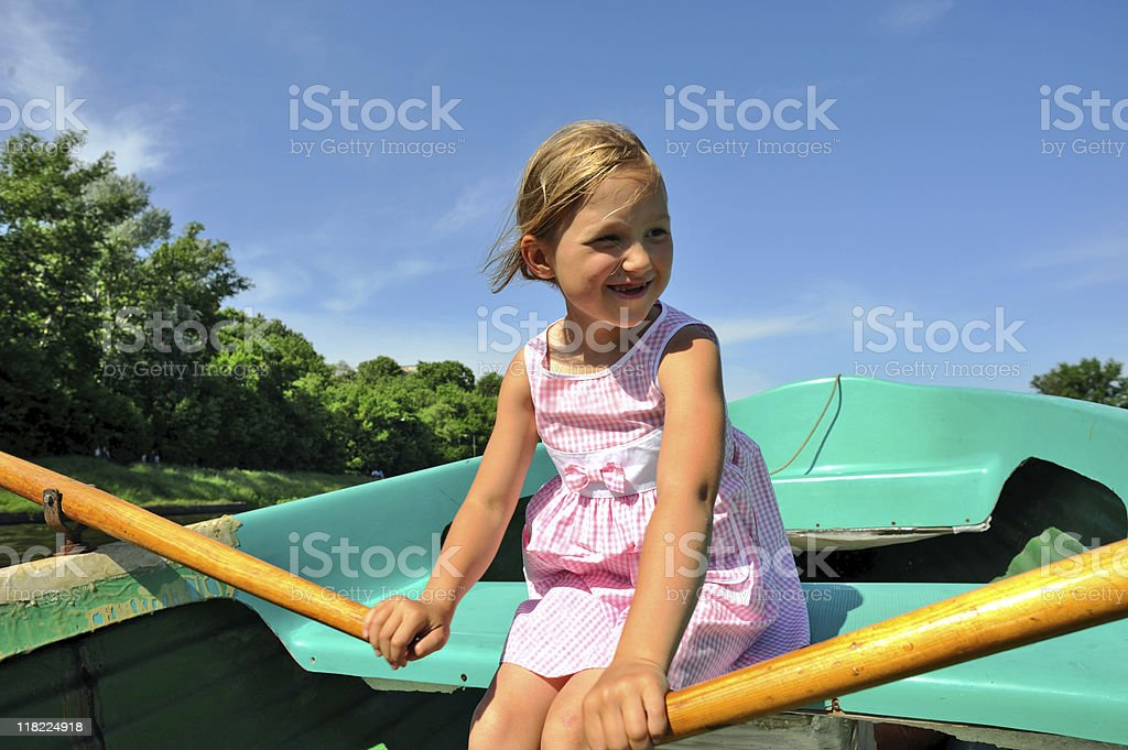 Child in boat royalty-free stock photo