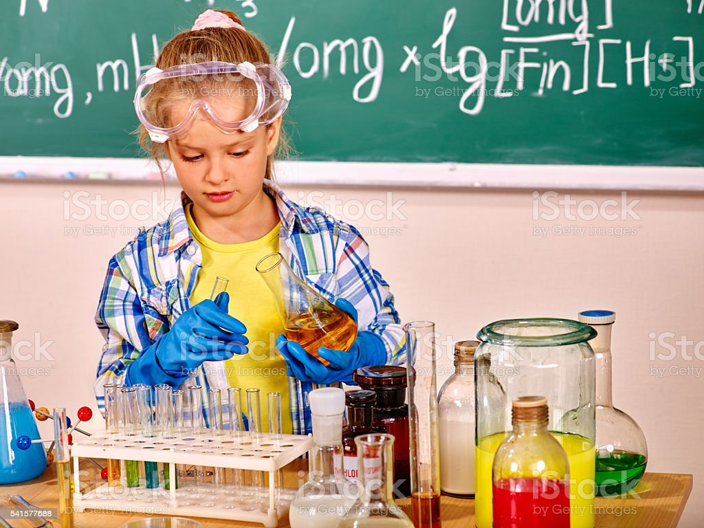 Child in chemistry class. stock photo
