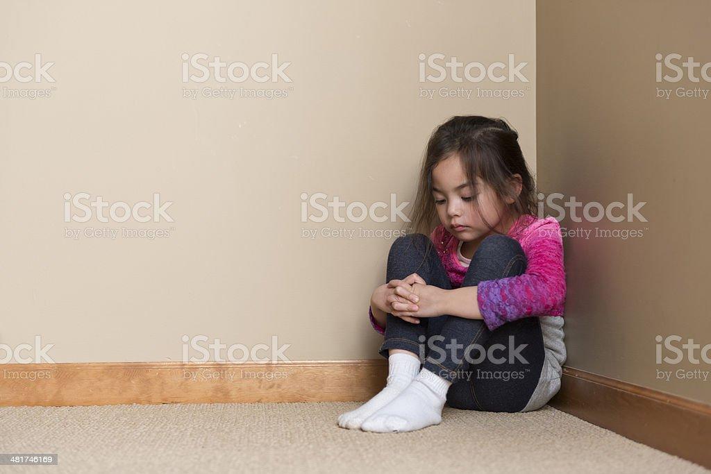 Child in Corner stock photo