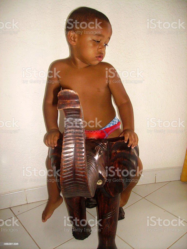 Child in Elephant stock photo