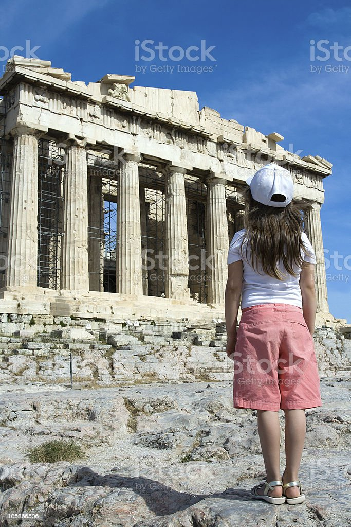 Child in front of Ancient Parthenon Acropolis Athens Greece. royalty-free stock photo