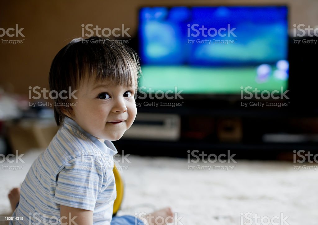 Child in front of TV stock photo
