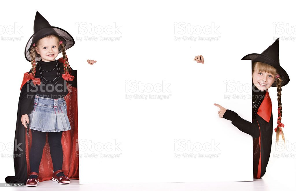 Child in Halloween witch costume with banner. royalty-free stock photo