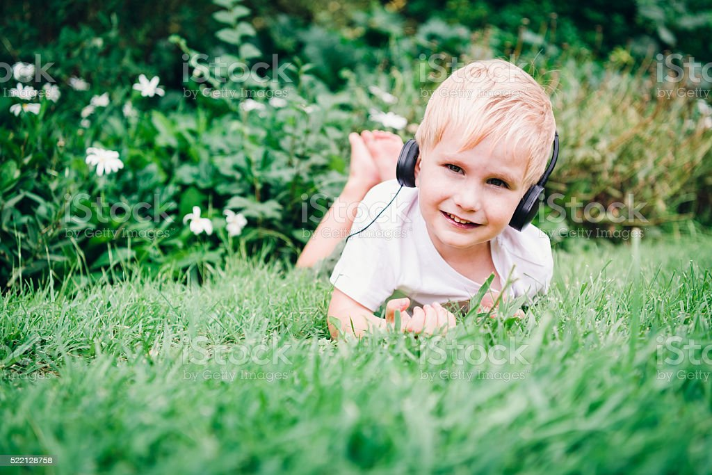 Child in headphones stock photo