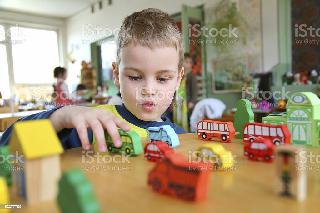 child in kindergarten stock photo