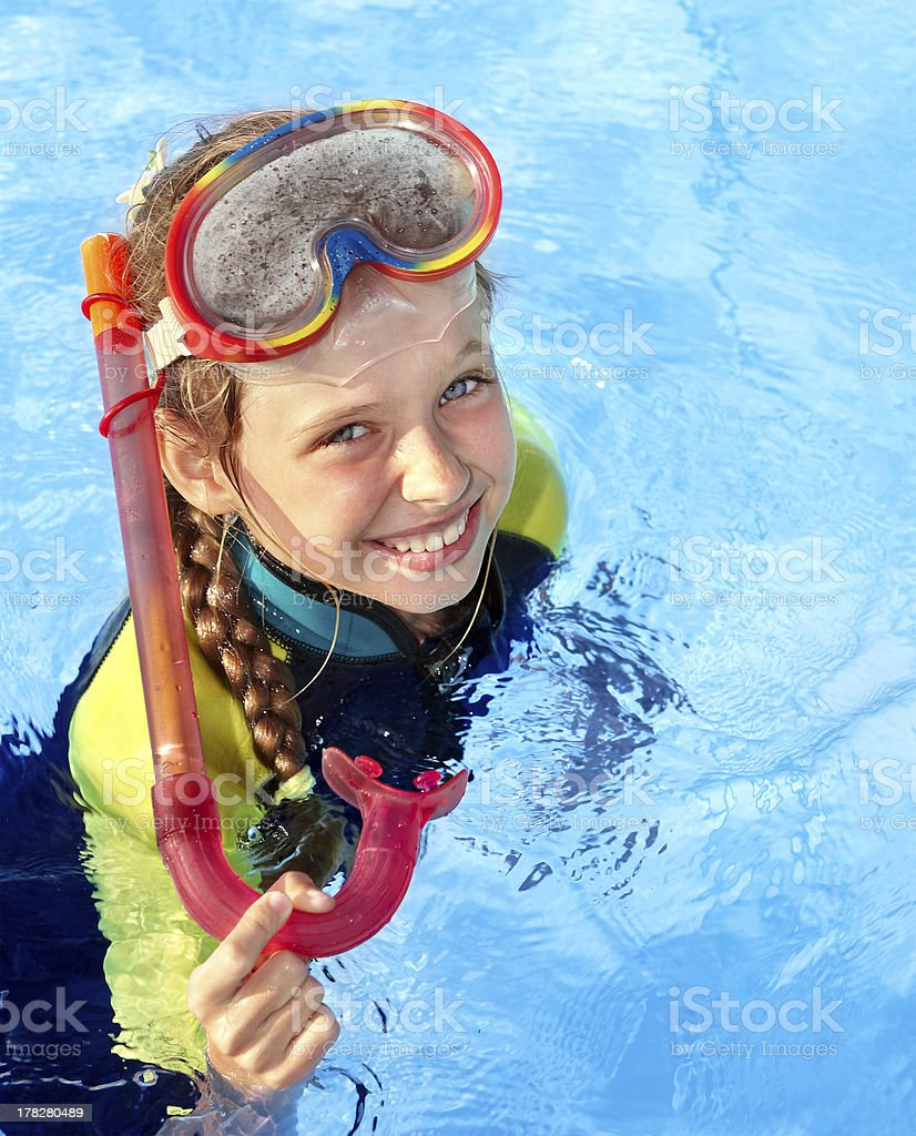 Child in swimming pool learning snorkeling. royalty-free stock photo