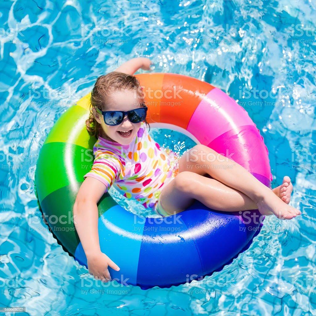 Child in swimming pool stock photo