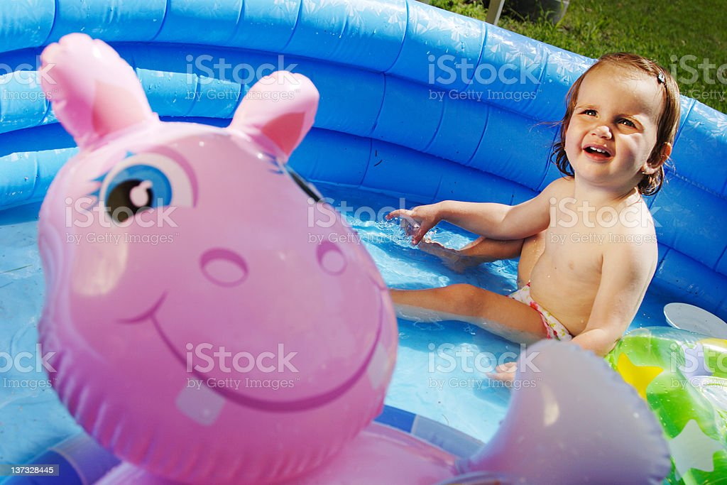 Child in swimming-pool stock photo
