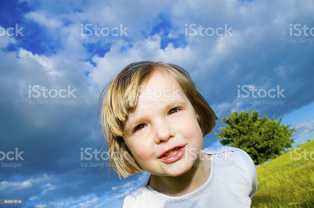 child in the meadow royalty-free stock photo