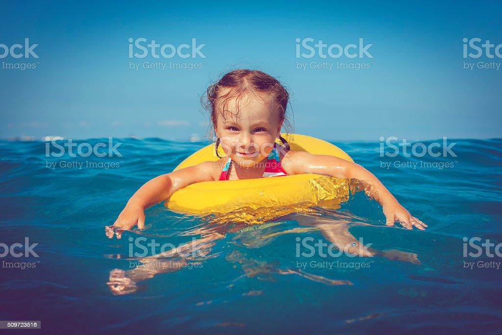 Child in the sea stock photo