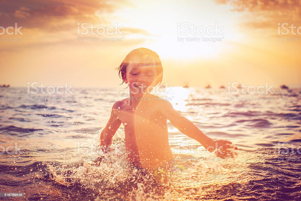 Child in the sea stock photo