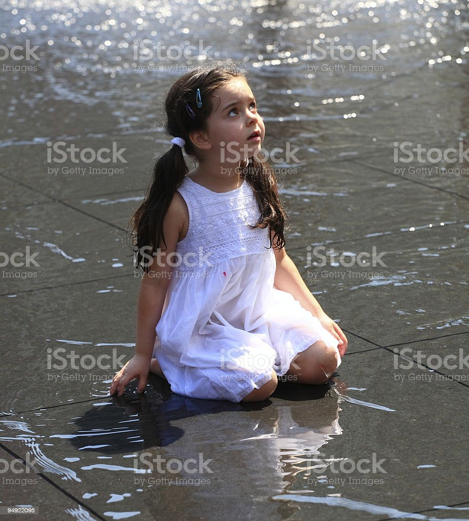 Child in the water stock photo