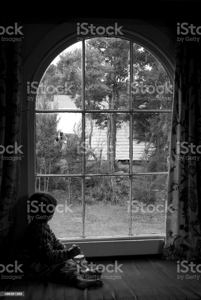 Child in Window royalty-free stock photo