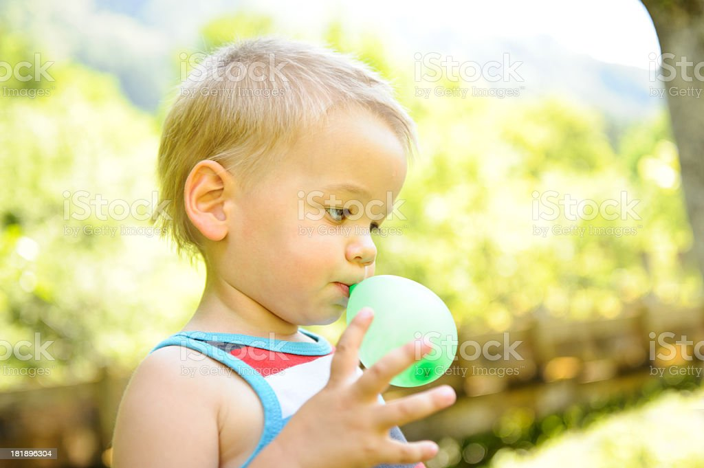 Child inflating balloon royalty-free stock photo