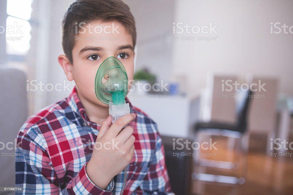 Child inhalation stock photo