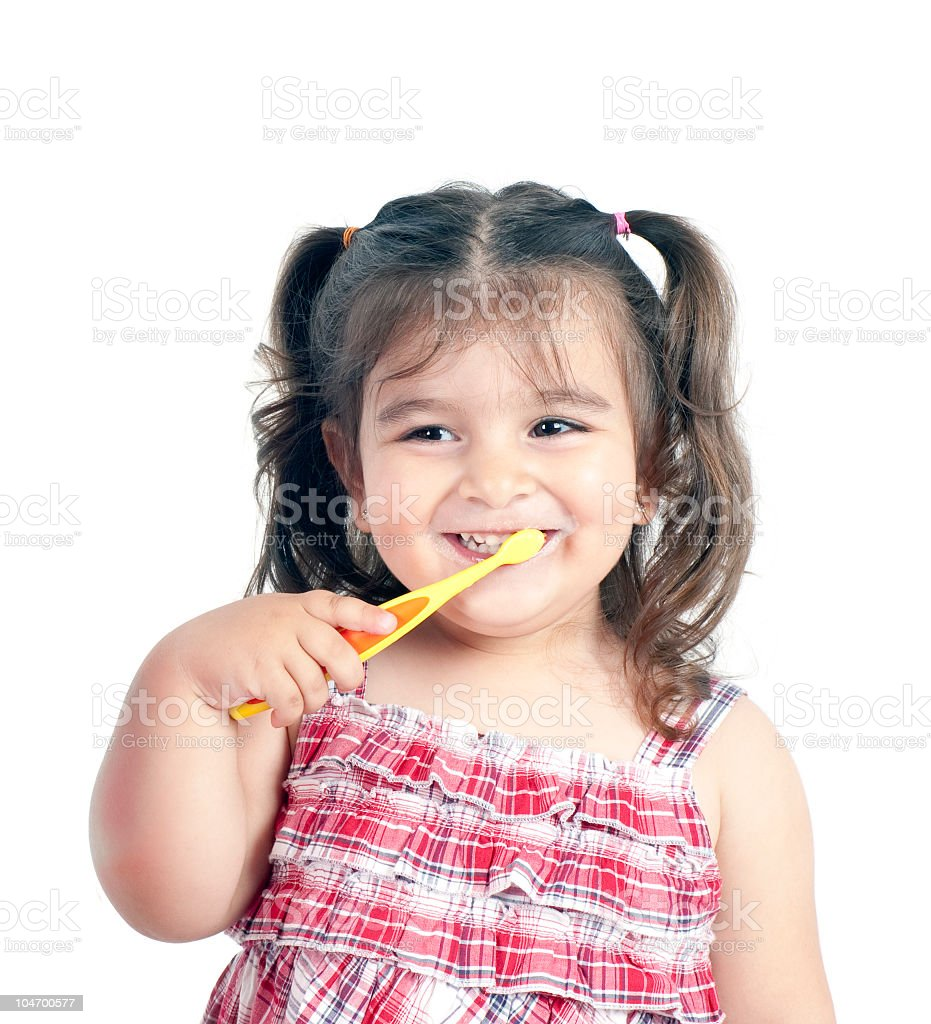 Child is brushing teeth stock photo