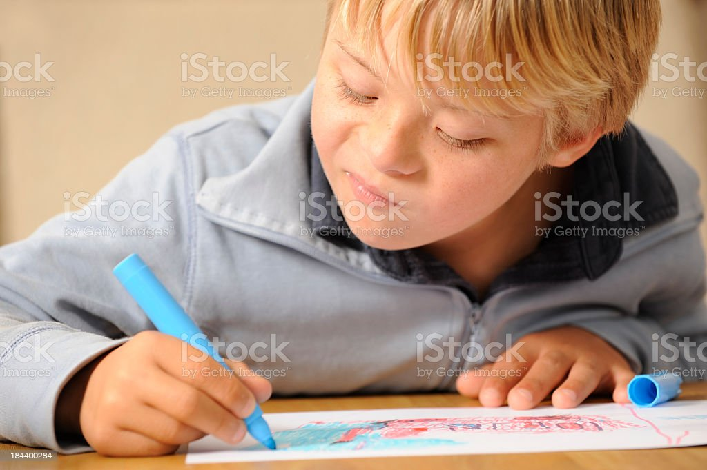 Child is drawing stock photo