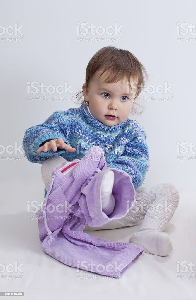 Child is dressing pants stock photo