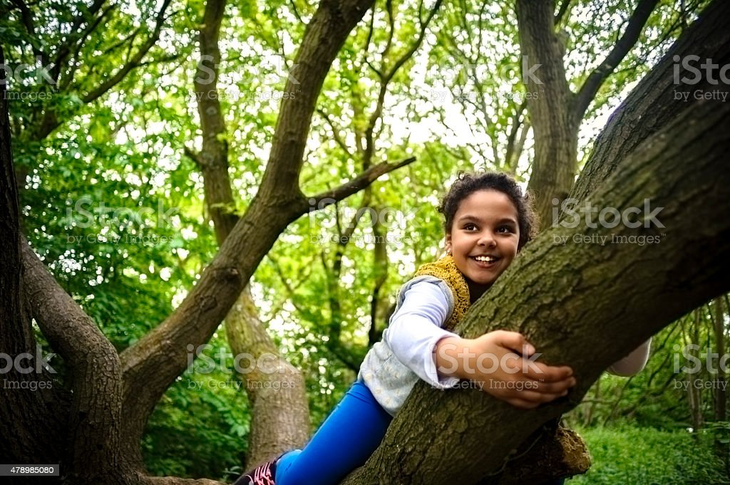 Child (8-9) Is Hanging On a Tree stock photo