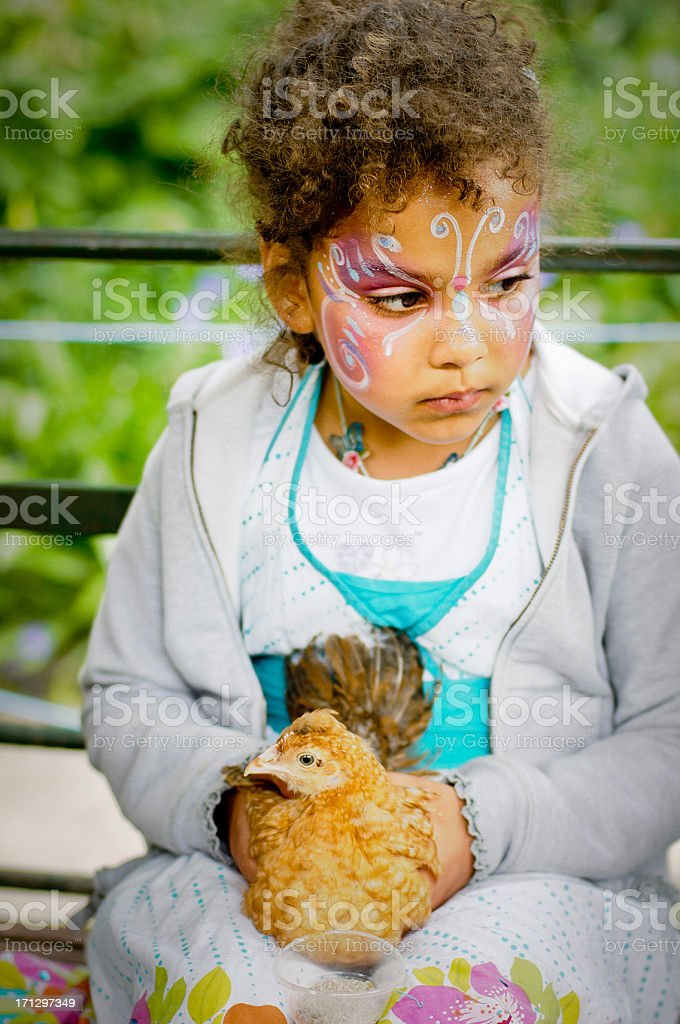 Child (6-7) Is Holding A Chicken royalty-free stock photo