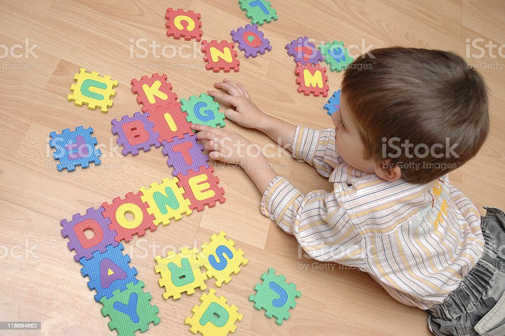 child is learning  letters stock photo