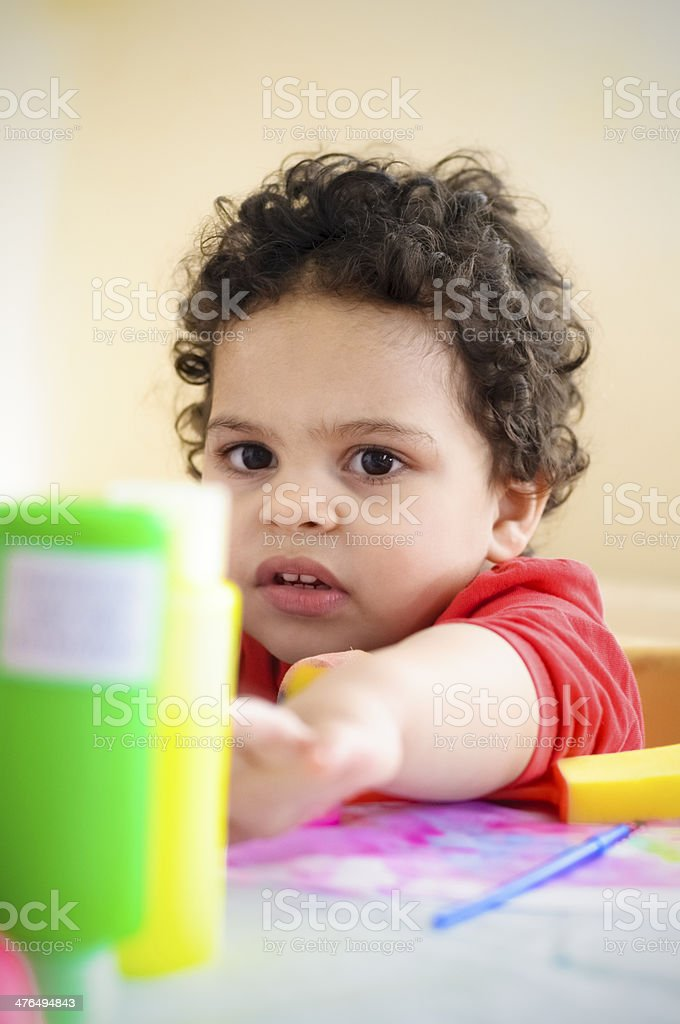 PEOPLE: Child (2-3)  Is Playing With Paint. royalty-free stock photo