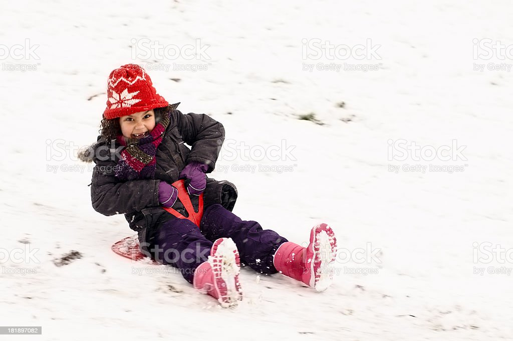 Child (6-7) is Sledding Down Hill royalty-free stock photo