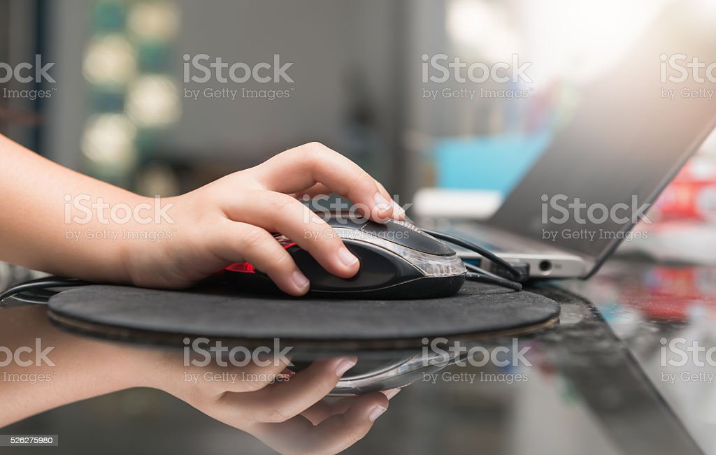 child is using a computer mouse stock photo