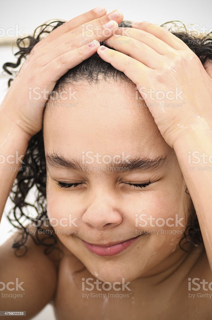 PEOPLE: Child (7-8) Is Washing Her Hair. royalty-free stock photo