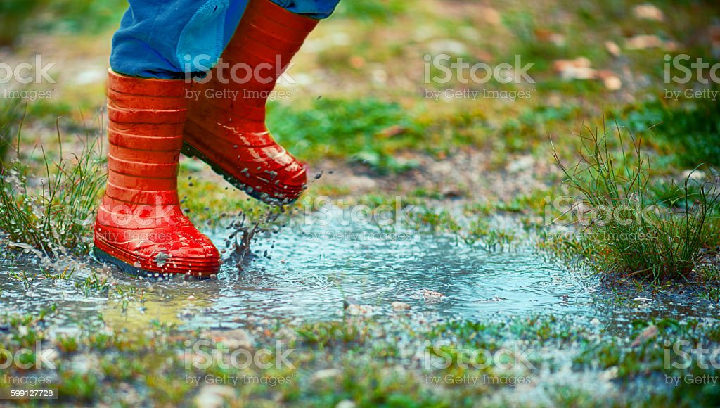 Child Jumping in a Puddle stock photo