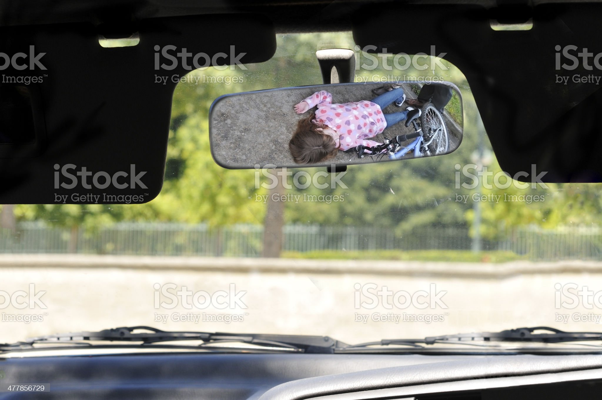Child knocked down, in rear view mirror royalty-free stock photo