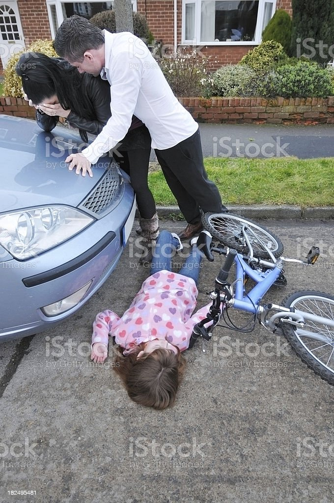 Child knocked off bike by car royalty-free stock photo