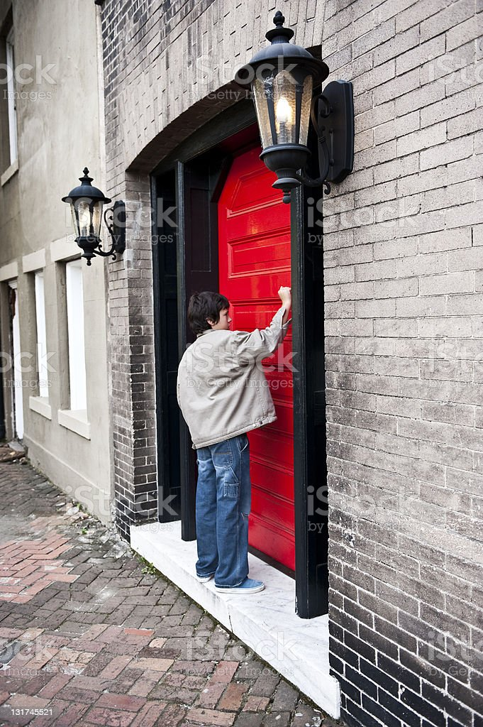 Child knocking a door royalty-free stock photo