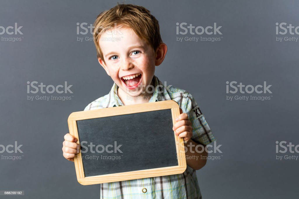 child laughing informing his learning and wellness from preschool stock photo