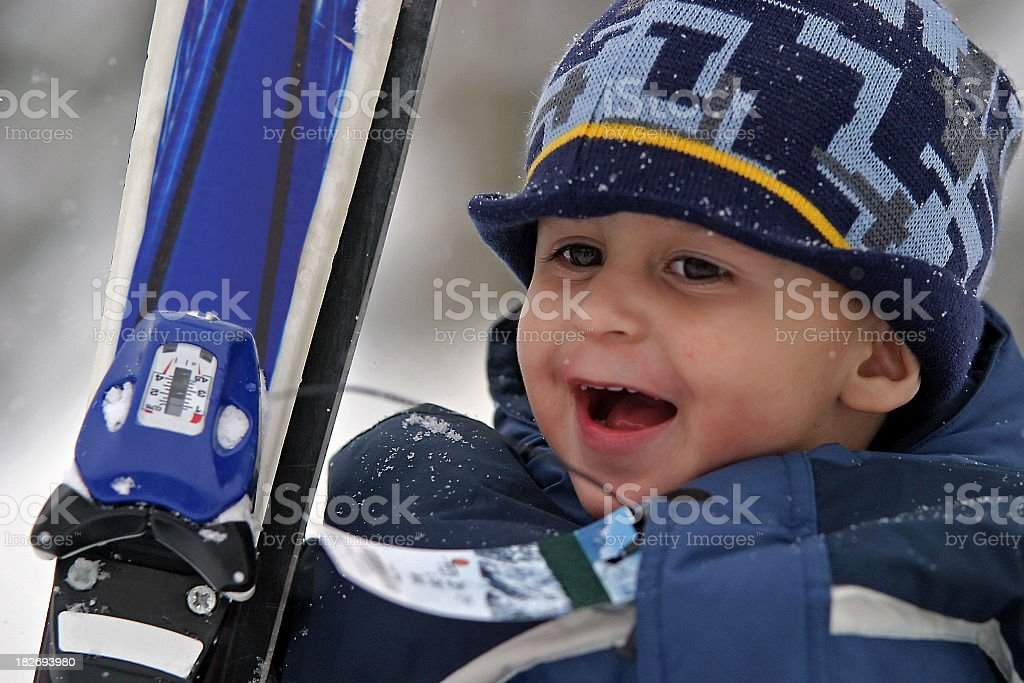 Child Laughing with Skis royalty-free stock photo