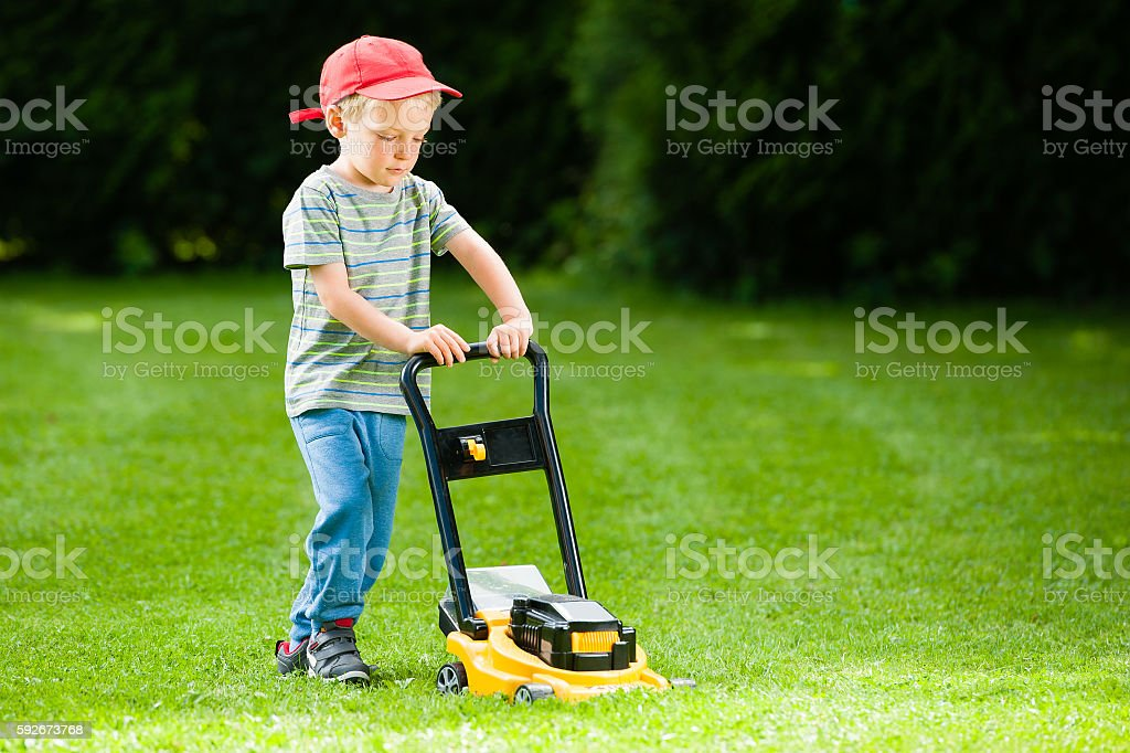 Child Lawn Mover Playing stock photo
