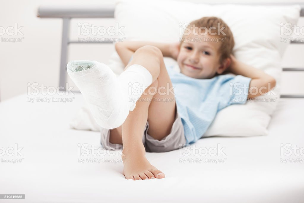Child leg heel fracture or broken foot bone plaster bandage stock photo