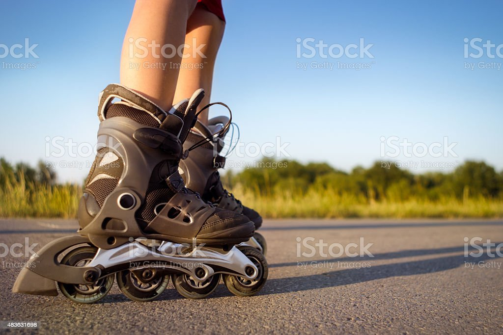 child  legs in rollers stock photo