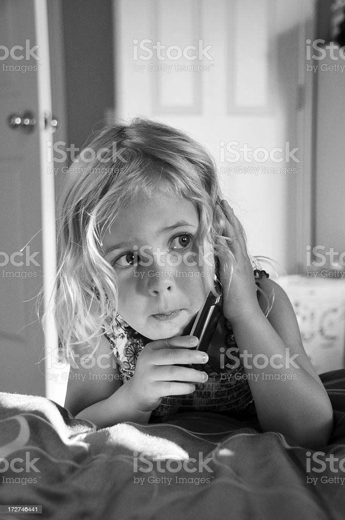 Child Listening to Cell Phone royalty-free stock photo