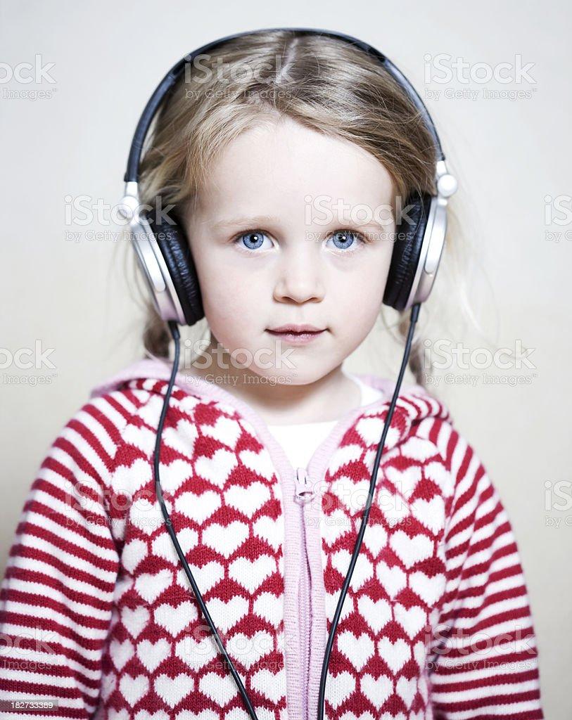 Child listening to music stock photo