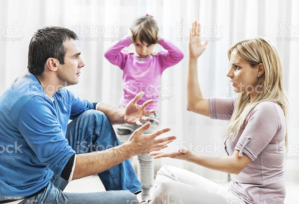 Child listening to their parents fighting royalty-free stock photo