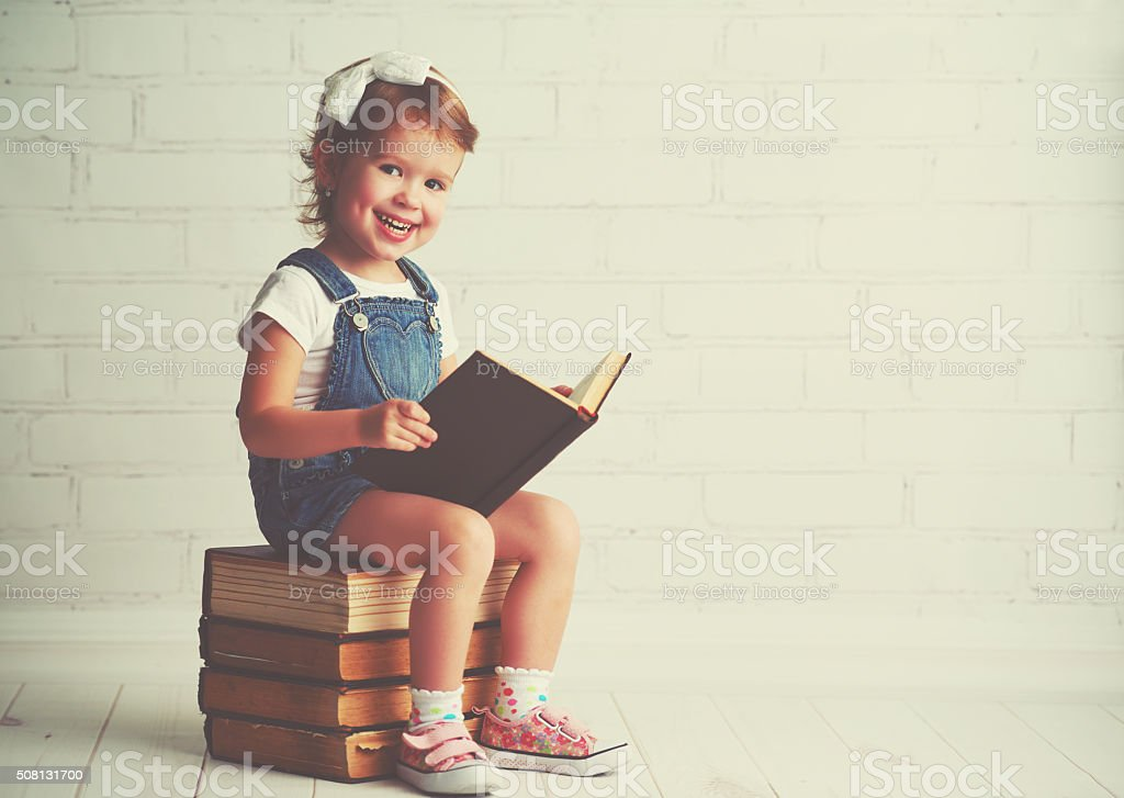 child little girl with books stock photo