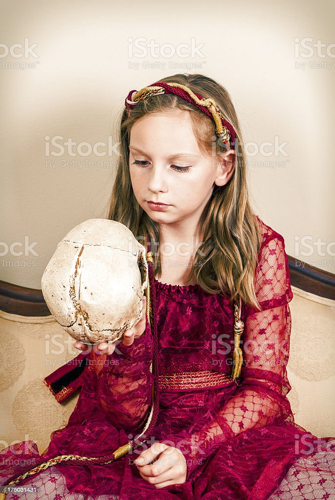 Child Looking At A Skull royalty-free stock photo