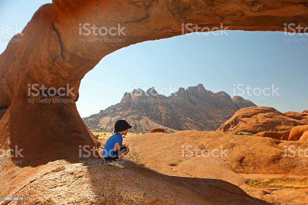 Child Looking at Spitzkoppe Landscape on Vacation in Namibia Africa stock photo