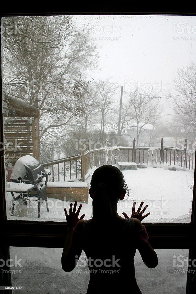Child looking out window royalty-free stock photo