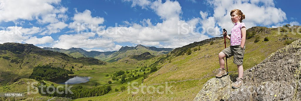 Child looking over idyllic big sky country mountain top panorama royalty-free stock photo