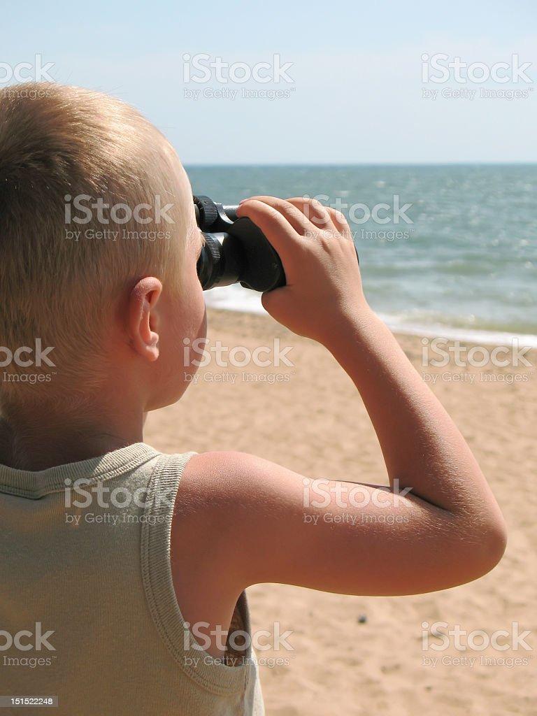 child looking through binoculars royalty-free stock photo