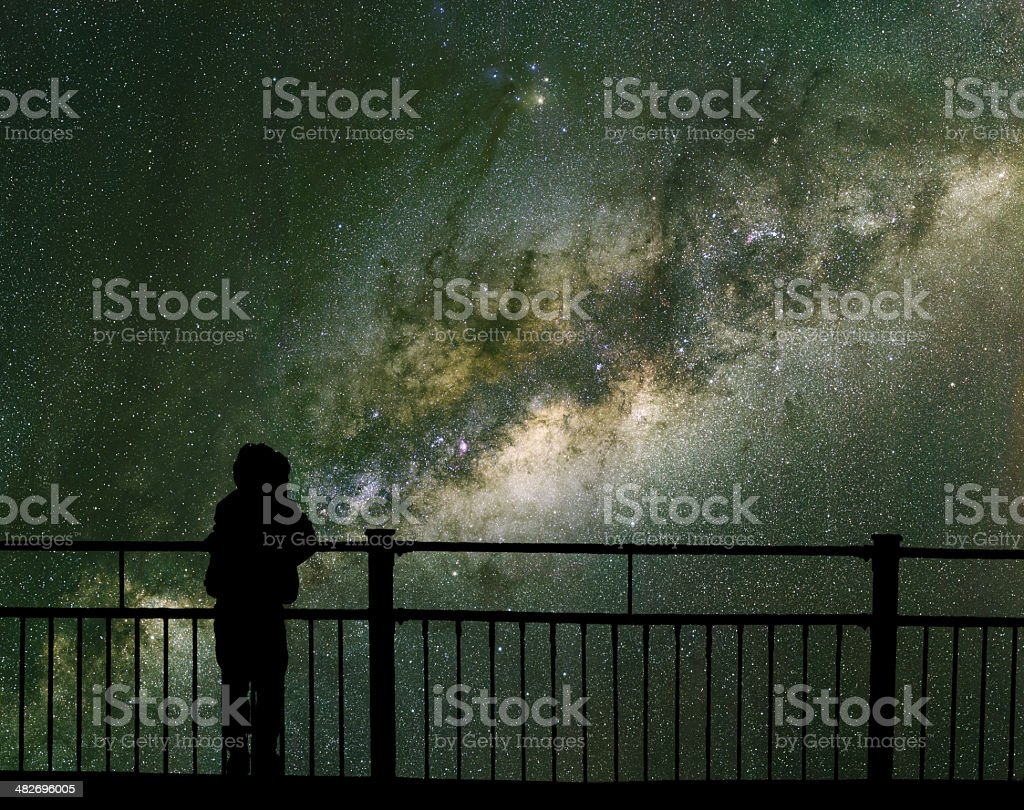 Child looks into space and the Milky way. stock photo